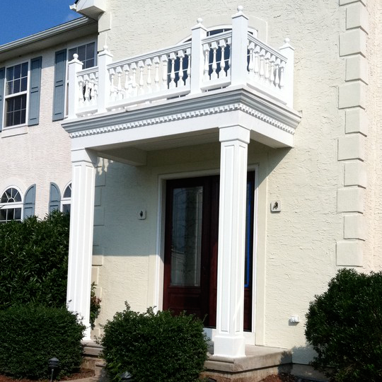 Add character to the outside of your home with a coordinating portico
